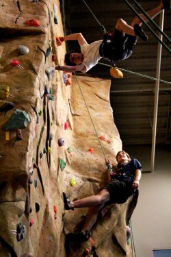 REACHING HIGH: Climbers at the Rec Center practice for the real thing. This summer's trips include climbs in the Carver area.