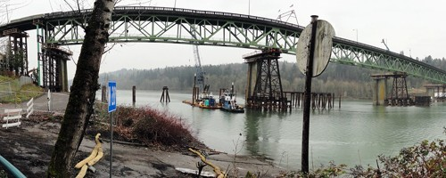A temporary span reaches across the Willamette River. Construction to replace the Sellwood Bridge is underway, and PSU engineering professors and students are learning and participating as the project develops. Photo  Mike Peterson/reportlandorgeon.wordpress.com