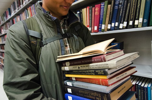 Buried in books: The library and PSU are encouraging community reading with their Everybody Reads program and its attendant short story competition. Photo by Daniel Johnston.